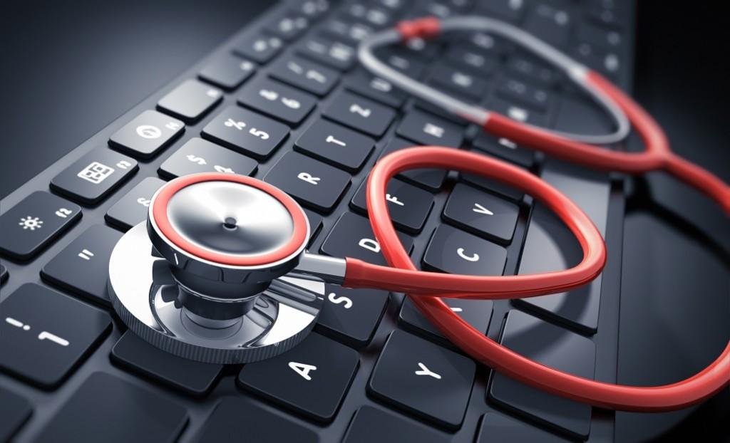 Rotes Stethoskop auf schwarzer Tastatur